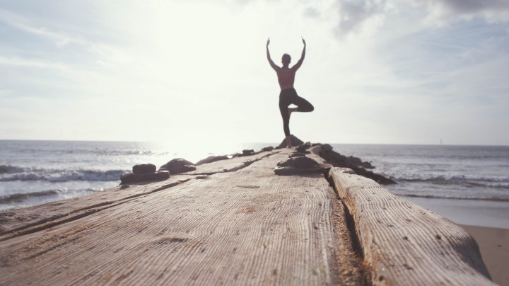 Find out how to stick to a yoga routine while traveling!